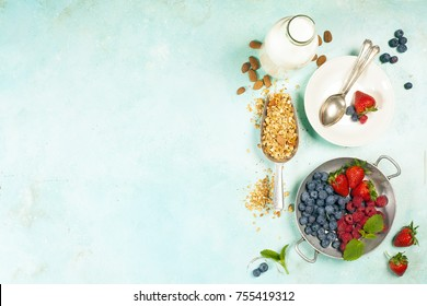 Granola. Breakfast set with granola, almond milk and berries. Healthy eating concept
