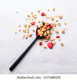 Granola Cereal bar with Strawberries in a spoonful Background .Breakfast. Healthy Food sweet dessert snack. Diet Nutrition Concept.Vegetarian food. Flat Lay.Top View. Copy space