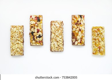 Granola cereal bars with nuts and dry fruits isolated on white background