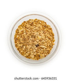 Granola cereal with dried frutis and nuts in a bowl isolated on white backgroung