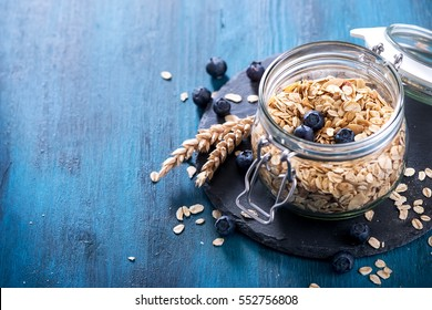 Granola, cereals or rolled oats and blueberries, healthy breakfast, copy space