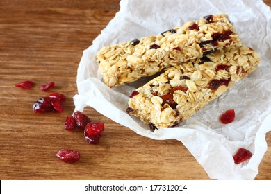 granola or energy bar on wooden background