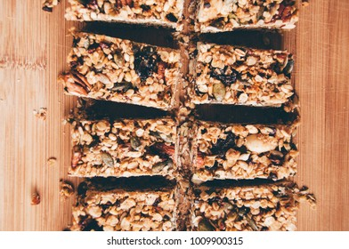 Granola flapjack bars on wooden board