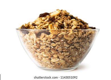 Granola in a glass plate close-up on a white, isolated.