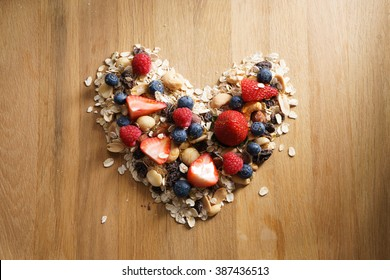 granola healthy snack with fresh berry in heart shaped