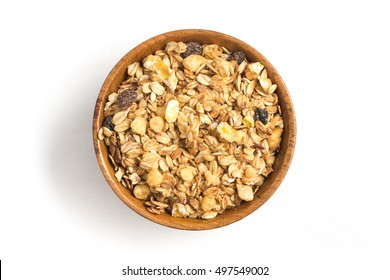 Granola into a bowl isolated in white background