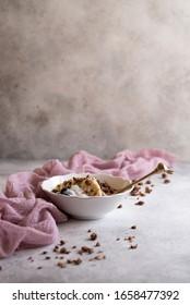 granola with natural yogurt, banana and blueberry