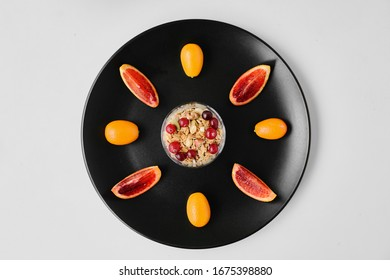 granola on a plate with fruit