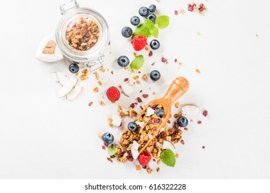 Granola from several types of cereals with nuts, coconut and berries