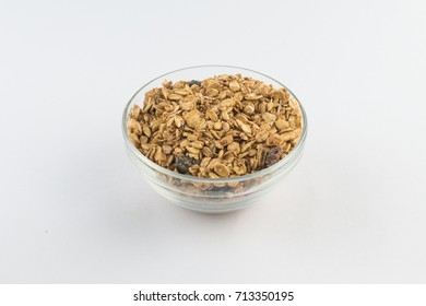 Granola. Toasted Oats into a bowl isolated on white background