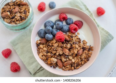 Granola with yogurt and berries for healthy breakfast on a table