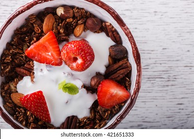 Granola with yogurt, strawberries.Healthy dry Breakfast.selective focus.