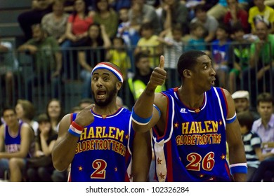 GRANOLLERS, SPAIN - MAY 11:  Dizzy Grant and Hi-Lite Bruton give a fun show at The Harlem Globetrotters game at Palau d'Esports in Granollers, Catalonia, Spain on May 11, 2012.