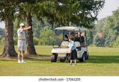 Granpa Instructing Grandson in Golfing