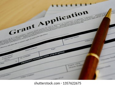 grant application with pen