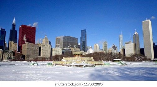 Grant Park and Buckingham Fountain covered in snow after blizzard, with the iconic skyline of downtown Chicago in background - Chicago, Illinois, USA (Winter)
