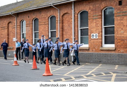 Grantham, United kingdom. 2 June 2019. 47F-Grantham ATC squadron air cadets marching towards the entrance of the train station.