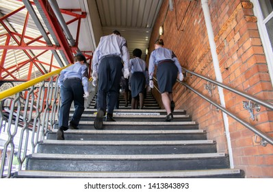 Grantham, United kingdom. 2 June 2019. 47F-Grantham ATC squadron air cadets climb stairs of Grantham train station.