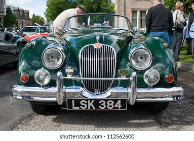 GRANTOWN ON SPEY, SCOTLAND - SEPTEMBER 2: Jaguar XK150 on display in the annual Motor Mania car show on September 2, 2012 in Grantown On Spey, Scotland