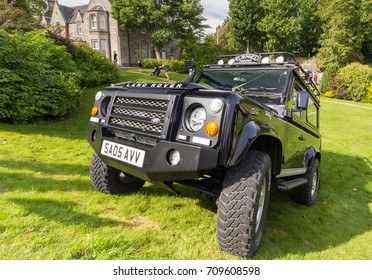 GRANTOWN ON SPEY, SCOTLAND - September 3 2017: Land Rover Defender parked on steep hill