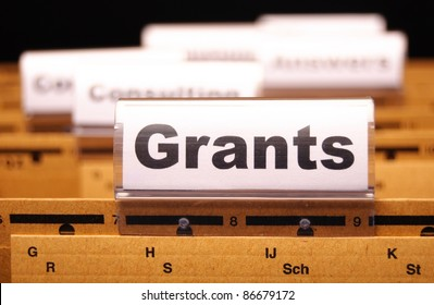 grants word on paper folder showing scholarship or higher education concept