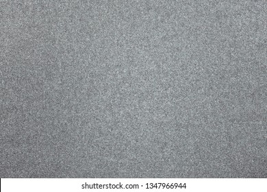 Granular abstract uniform grainy surface.