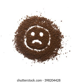 Granular coffee with sad face sign