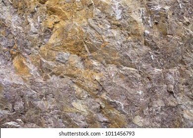 Granular limestone rock surface. Roe stone rock surface. Limestone crag texture. Roe-stone crag face. Limestone stone surface desktop pattern. Calcite crag idle screen. Calcspar reef desktop backdrop