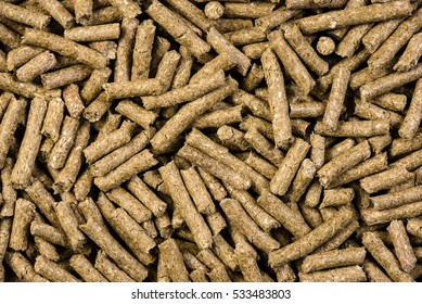 granulated animal food background texture isolated on black
