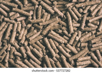 granulated animal food background texture isolated on black - vintage film effect