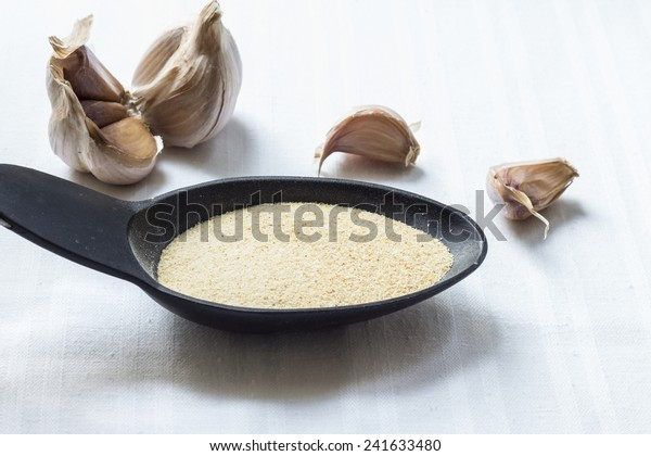 Granulated garlic on white texture