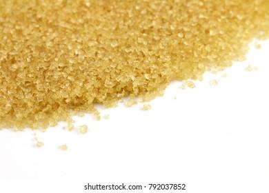 granulated sugar, brown sugar from sugarcane, background granulated sugar yellow, sucrose sugar red