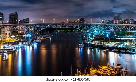 Granville Bridge along False Creek long exposure at night Vancouver BC. Vancouver is the third most populous metropolitan area and is the most ethnically diverse cities in Canada.