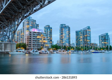 Granville Bridge along False Creek at Night in Vancouver BC. Vancouver is the third most populous metropolitan area and is the most ethnically diverse cities in Canada.