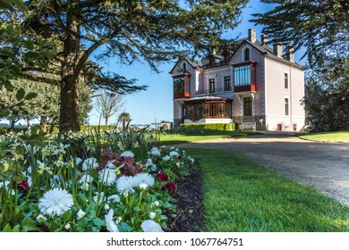 Granville, France - APRIL 5, 2018: The central alley leading to the House is the Christian Dior Museum. Granville, France.