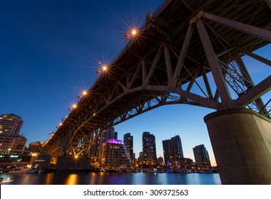 Granville Island Bridge in Vancouver from below on a clear night