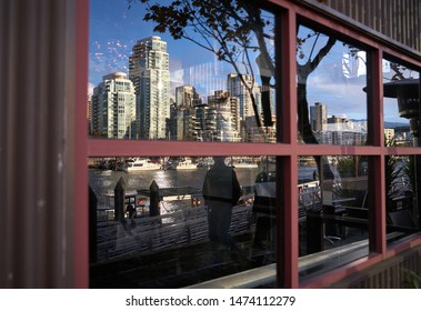 Granville Island Downtown Reflections. Yaletown and False Creek Marina viewed from Granville Island. Vancouver, British Columbia, Canada.