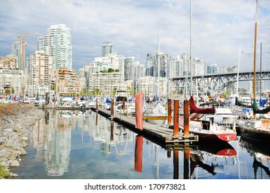 Granville Island Harbor with the Vancouver skyline in the background, BC, Canada
