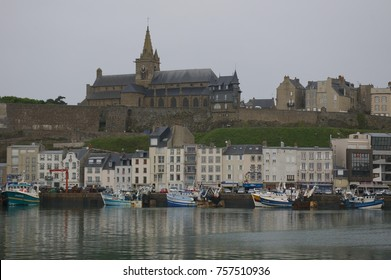 Granville, Normandy, France. 8 April 2012. Notre-Dame Church, harbour buildings and boats.
