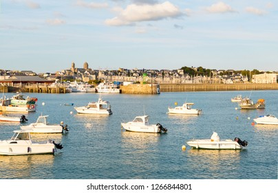 Granville, Normandy, France - August 25, 2018: The harbour of Granville, with church of Saint-Paul in the background, Normandy, France.