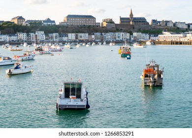 Granville, Normandy, France - August 25, 2018: The harbour of Granville, with Notre-Dame church in the background, Normandy, France.