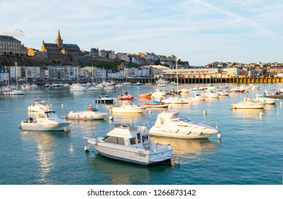 Granville, Normandy, France - August 25, 2018: The harbour of Granville, with Notre-Dame church in the background. Normandy, France.