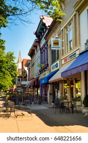 GRANVILLE, OH - MAY 15, 2017: Shops, businesses, and dining establishments with sidewalk seating line the downtown block of this charming village about 30 miles east of Columbus.