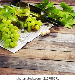 Grape, a bottle and glass of  white wine with grape in vintage style