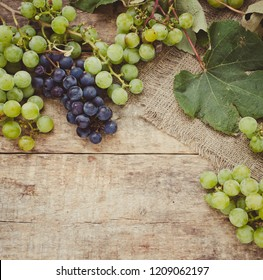 Grape bunches on a wooden abckground/toned photo