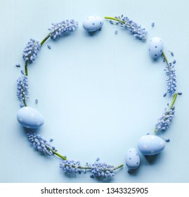Grape hyacinth flower and easter eggs flat lay
