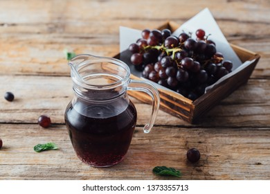 grape juice on wooden table background