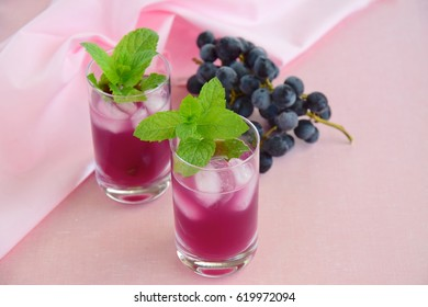 Grape mint soda mocktail with fresh grapes background