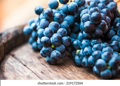 Grape on a wooden barrel. Macro image.