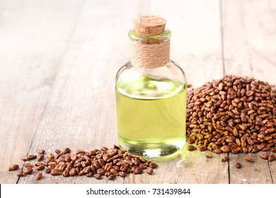 grape seed oil and grape seeds on the table
